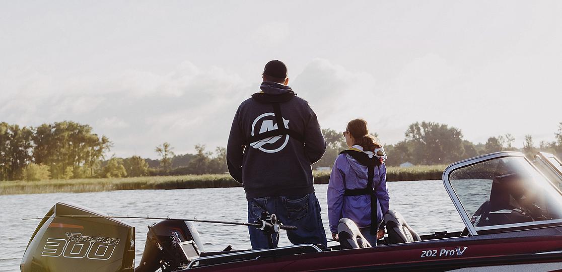 Man girl water fishing Mercury 300r boat