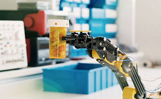 robotic arm holding a bottle of pills