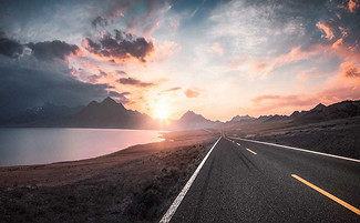 sunset clouds and open road