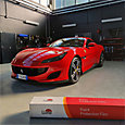 LLumar PPF keeps this red Ferrari Portofino protected from road damage and looking its best