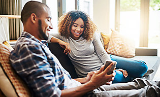 Couple looking at window film benefits on mobile device