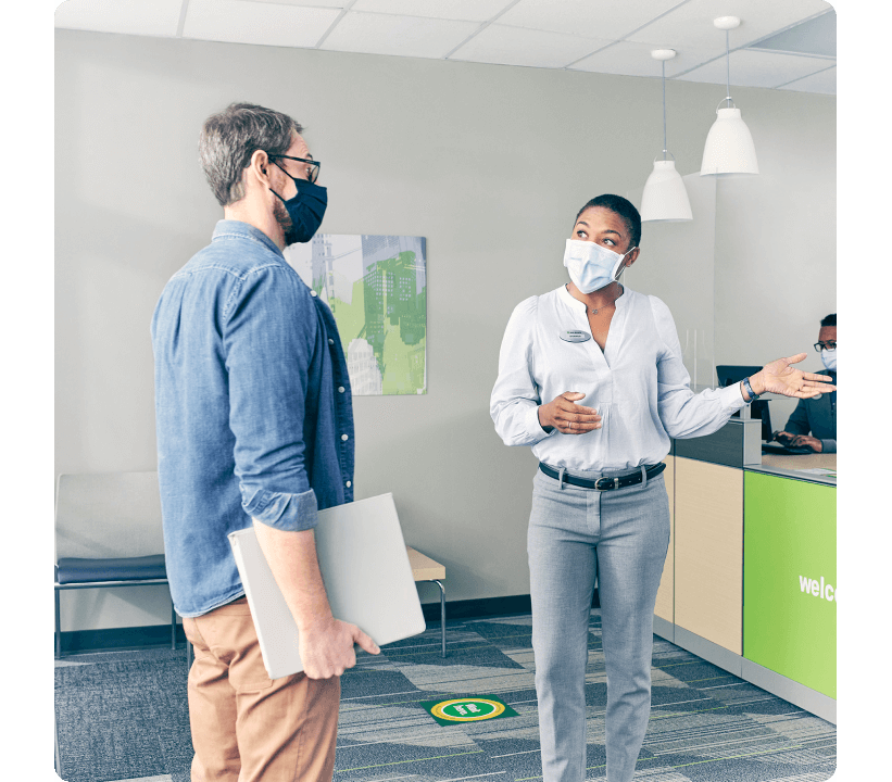 Tax pro greeting customer with masks on