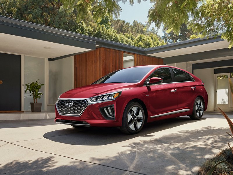 2020 Ioniq Hybrid in Scarlet Red Pearl parked at house