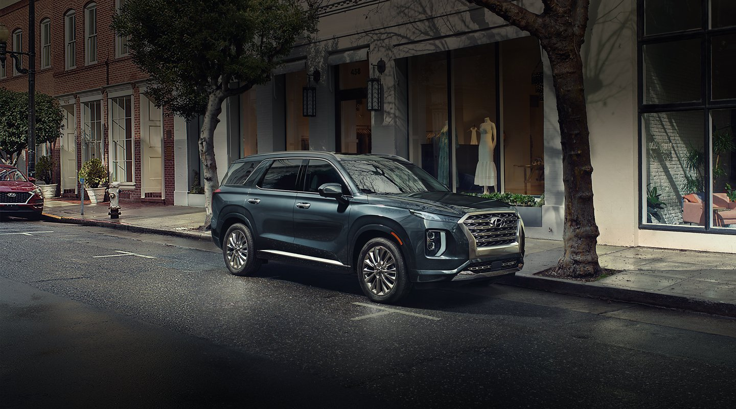 2020 hyundai palisade parked in front of shop