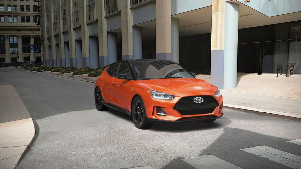 360 Exterior Image of the 2021 VELOSTER in Sunset Orange