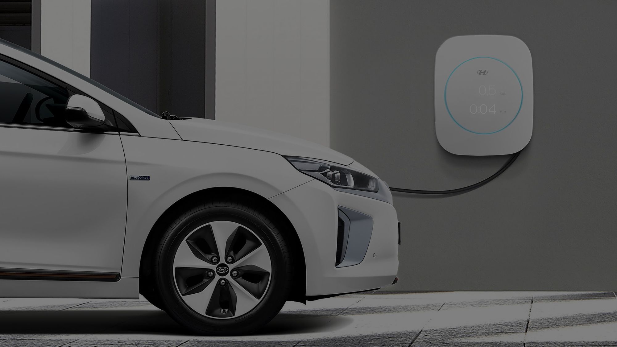 Hyundai white car getting charged on a Hyundai wall electric charger