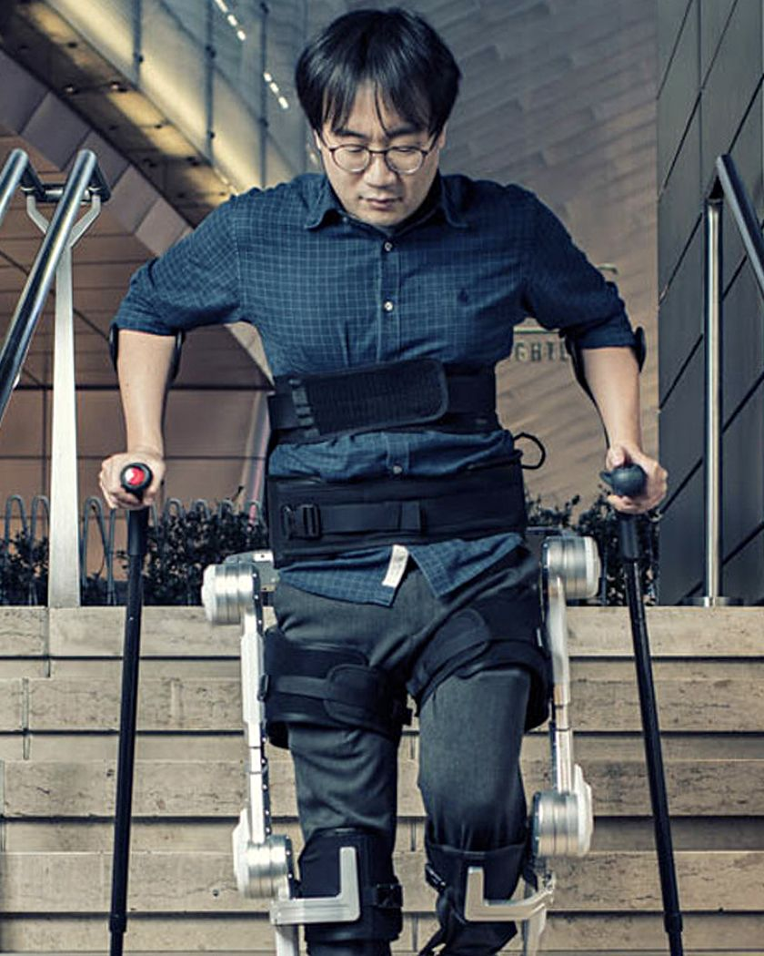 Hyundai engineer walks down the stairs with Hyundai's Exoskeleton