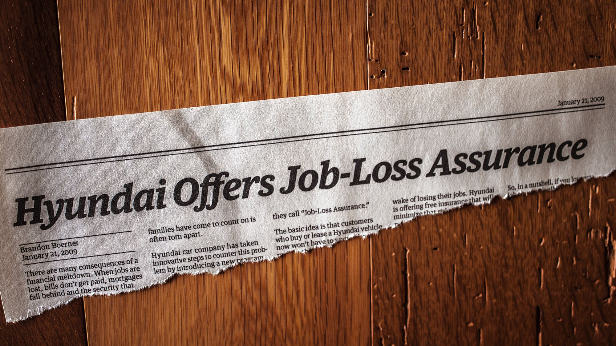 Newspaper clipping from January 2009 with headline that reads Hyundai Offers Job-Loss Assurance