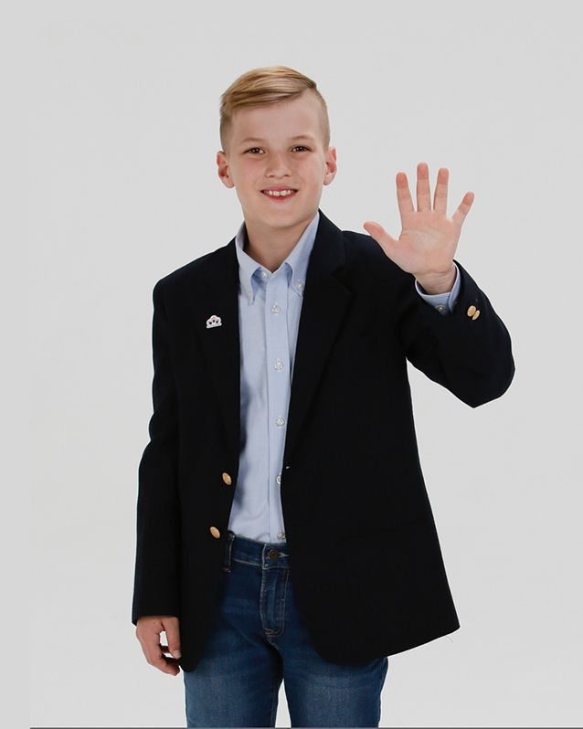 Portrait of Alex holding his hand up wearing a blue dress shirt
