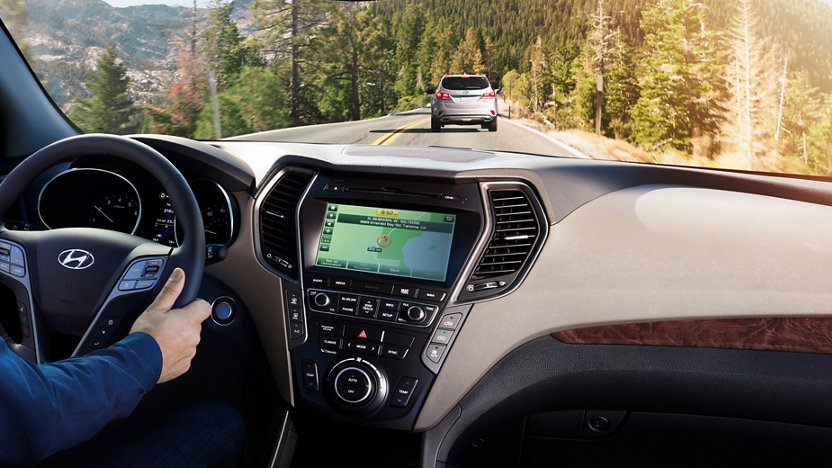 Interior of a Hyundai vehicle driving on a wooded road