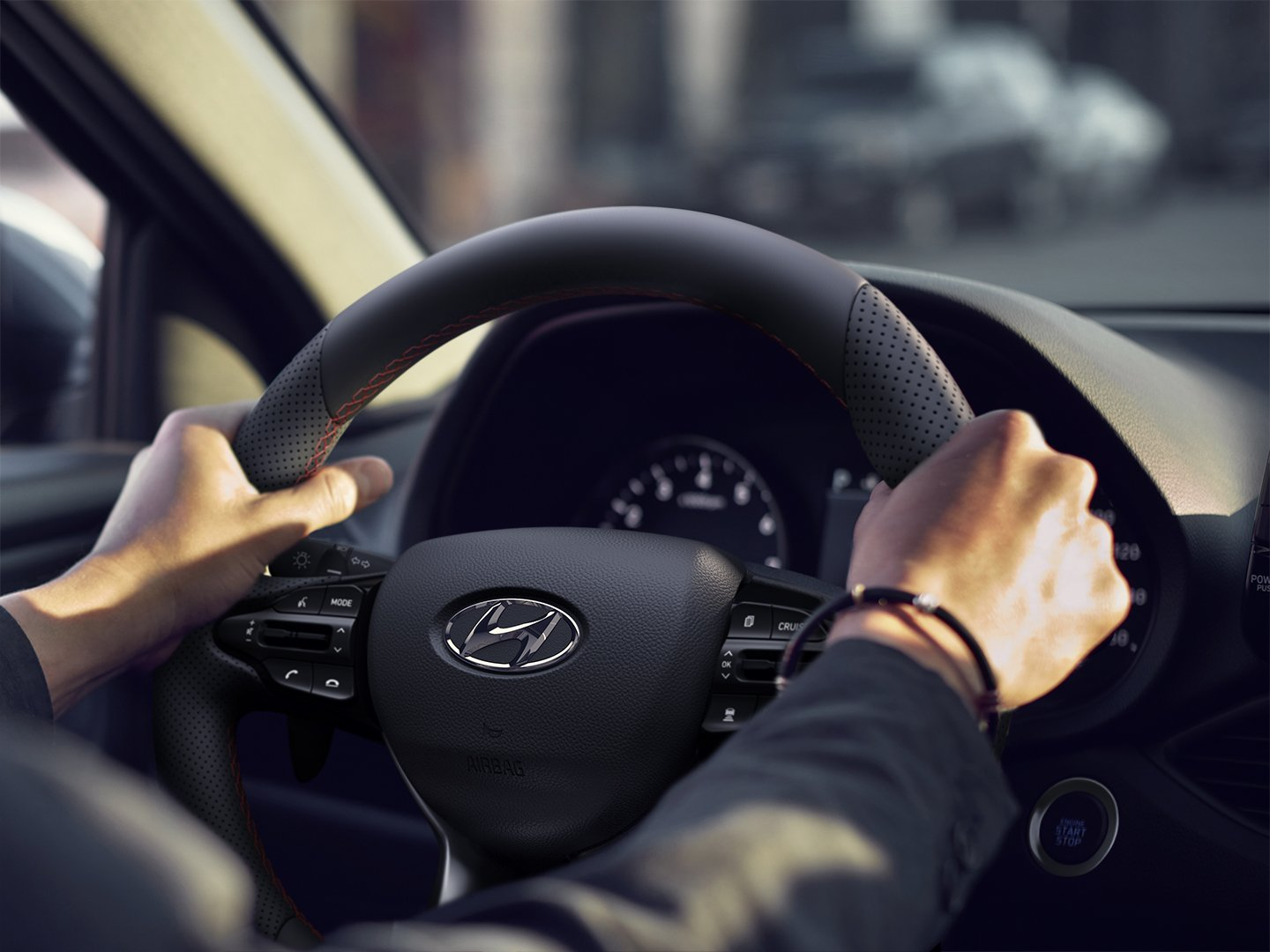 Hyundai Drive App hands on steering wheel