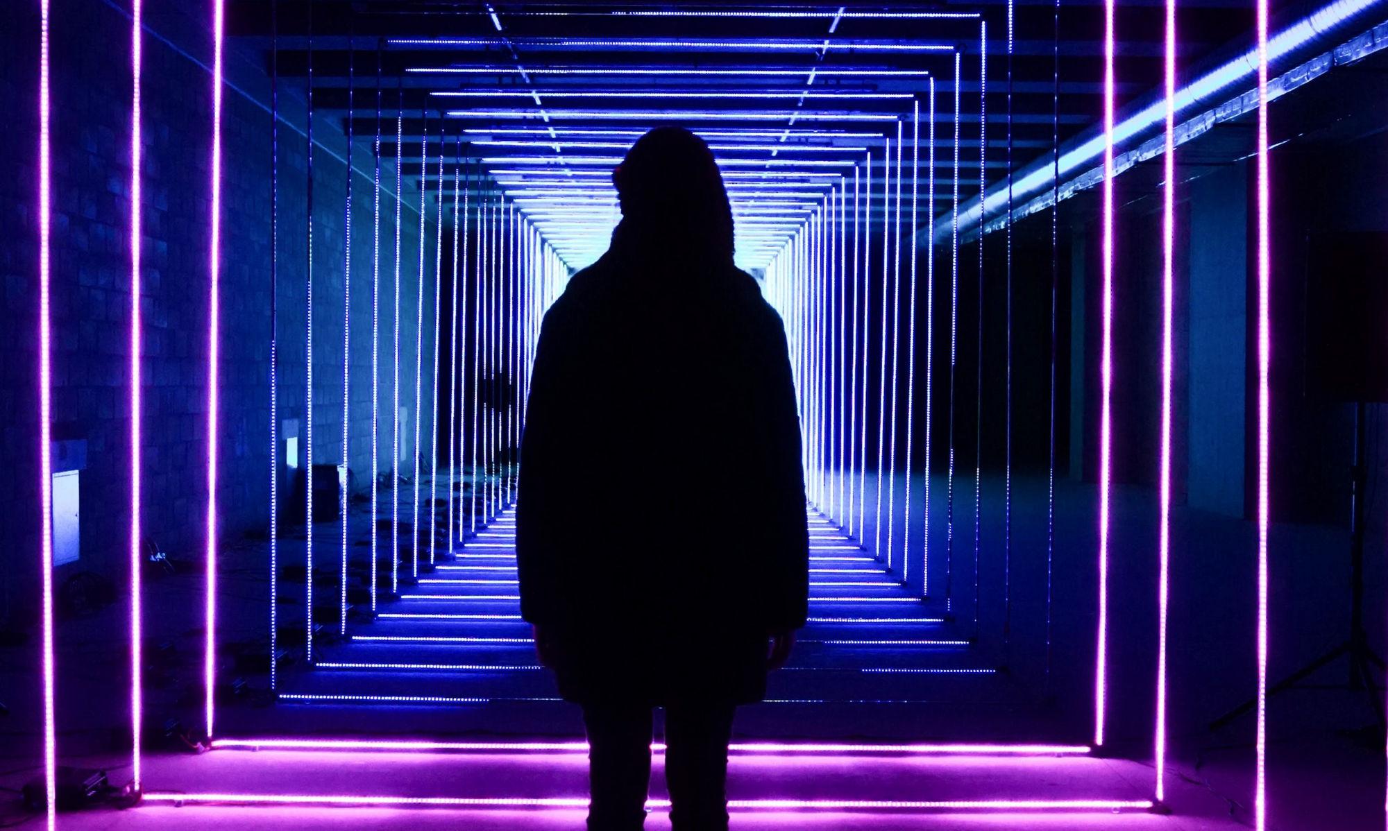 Silhouette in neon lit hallway