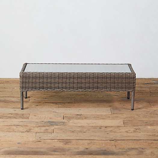 View larger image of Glass Top + Wicker Coffee Table