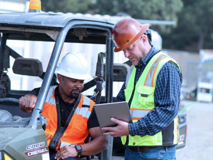 Construction workers working off a tablet connected to business internet