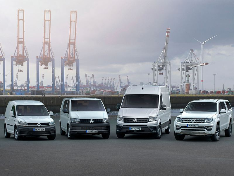 Four VW commercial vehicles in a row