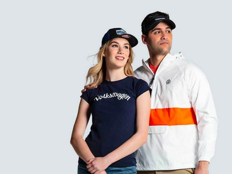 A man and woman wearing VW gear