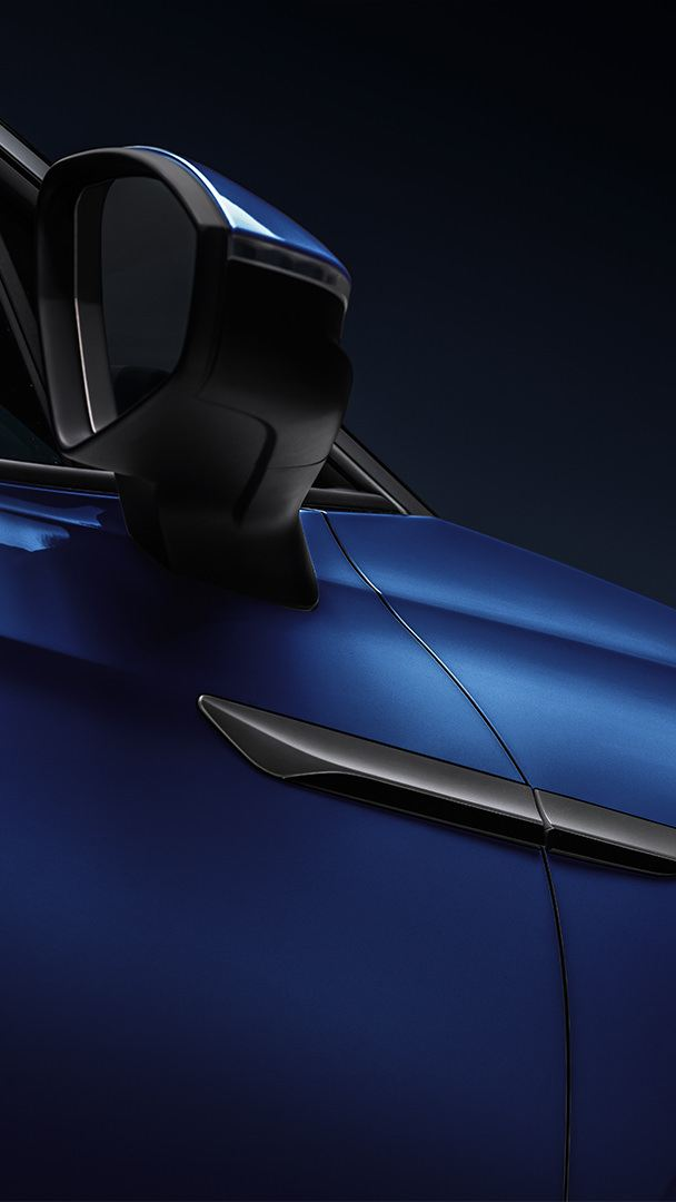 A closeup of the passenger's side of an ID.4 in Dusk Blue Metallic