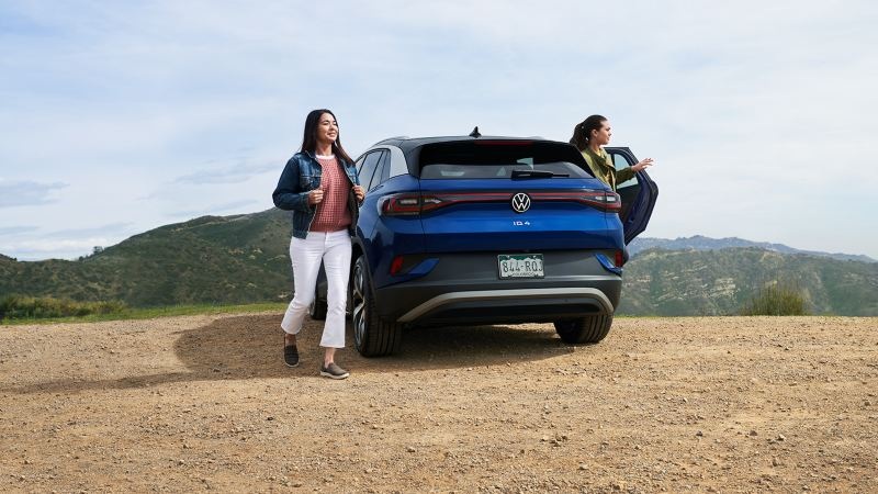 Two women get out of the ID.4 near a scenic overlook