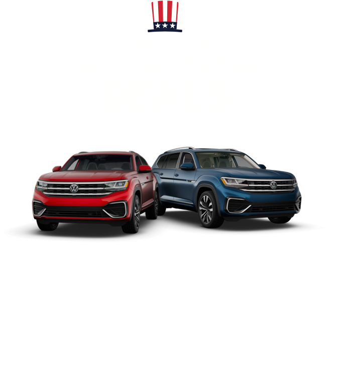 A head-on view of a VW Atlas Cross Sport, in Aurora Red Metallic and a VW Atlas, in Tourmaline Blue Metallic.