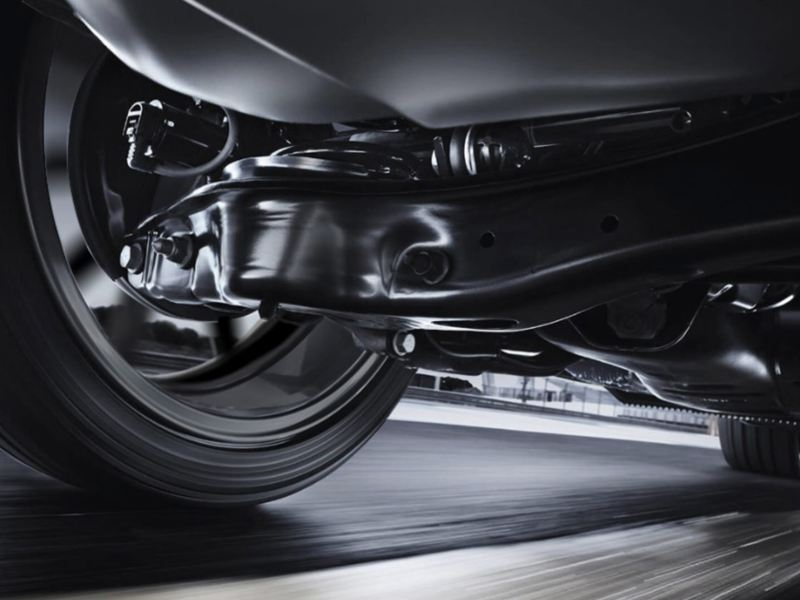 Undercarriage close-up of the Golf GTI suspension while in motion.