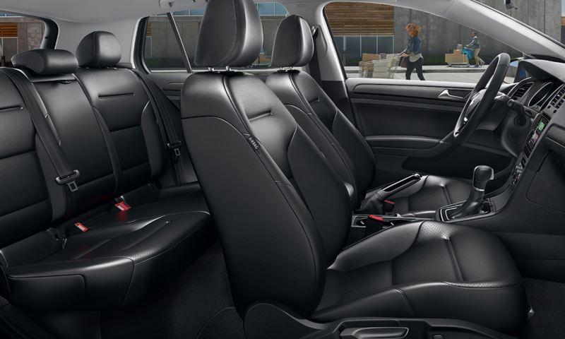 A Titan Black V-Tex leatherette interior of a Volkswagen Golf