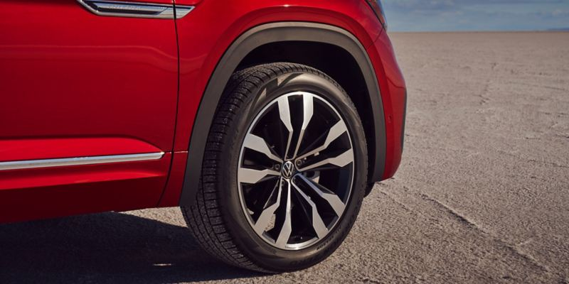 """Close-up shot of the Cross Sport badging and a 21"""" alloy wheel on the front passenger side."""