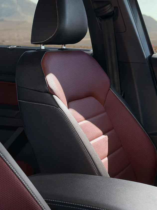 The heated seats of the Atlas Cross Sport in Dark Burgundy and Titan Black Two-Tone Vienna Leather.