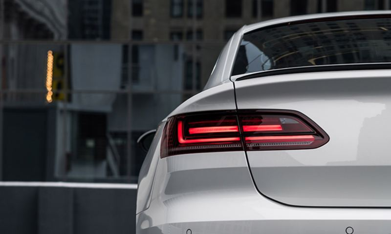 The rear angle view of a Pure White Arteon parked on the street