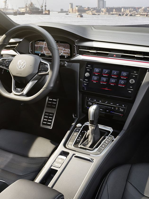 """Driver side interior view of Arteon with standard 8"""" Discover Media touchscreen smart navigation system and Volkswagen Digital Cockpit"""