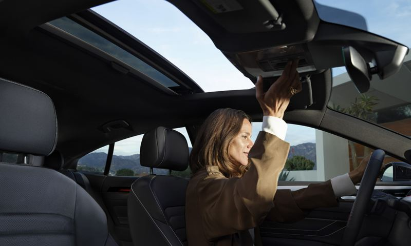 A driver opens the available panoramic sunroof