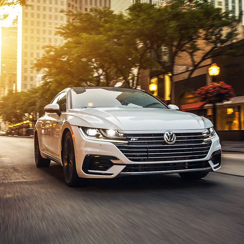 Pure White Arteon driving on a road.