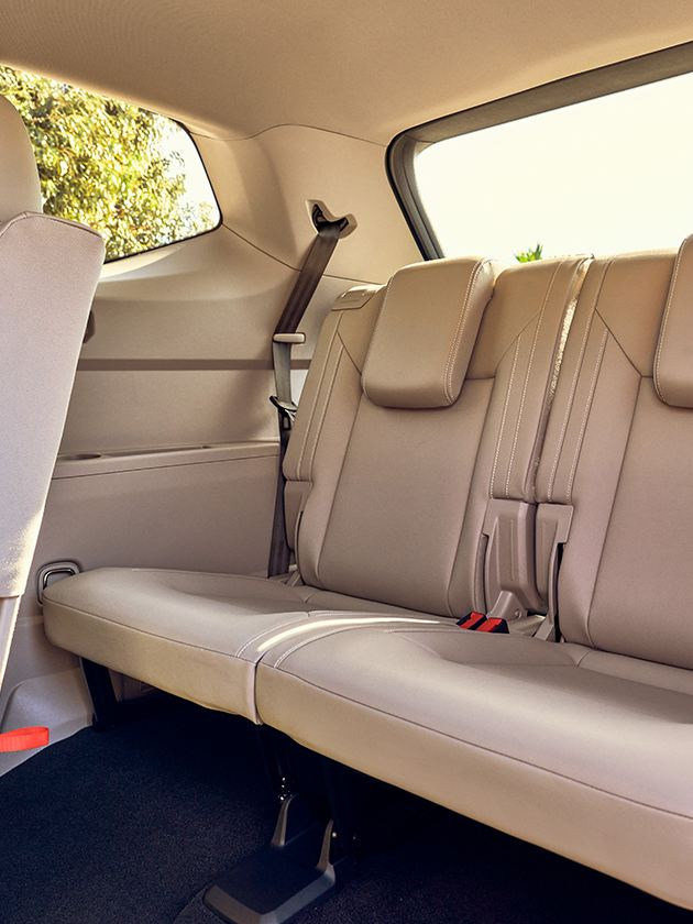 Atlas shown in Shetland Beige V-Tex leatherette with middle row seat tilted and slid forward.
