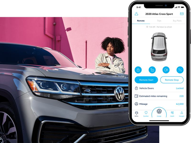 A woman stands next to an Atlas Cross Sport, shown parked in Platinum Silver Metallic. To the right, the VW Car-Net app interface is displayed on a compatible phone.
