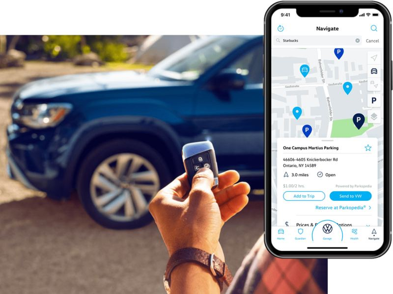 A man clicks his VW remote standing near his vehicle. On his phone, we see the in-app Volkswagen Car-Net® Remote Access parking info.