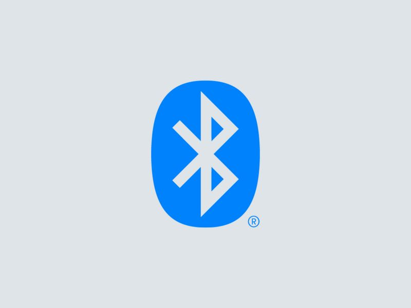 Woman uses Bluetooth® technology to stream audio.