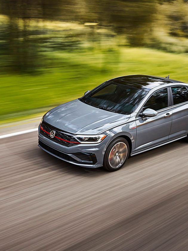 Jetta GLI in Pure Gray driving as seen from the front. Color adds an additional $295 to price of car.