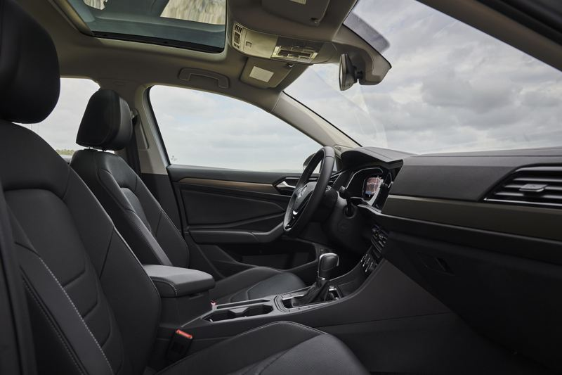 A side view of a Jetta showcasing its interior in available Titan Black leather.