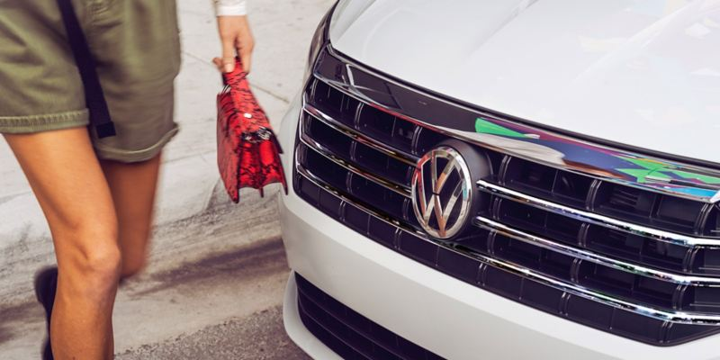 Up close view of the Jetta front grille as a woman walks by.