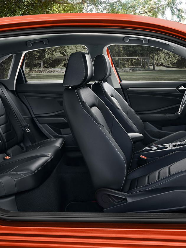 A side profile of a Jetta showcasing its interior in available Titan Black leather.