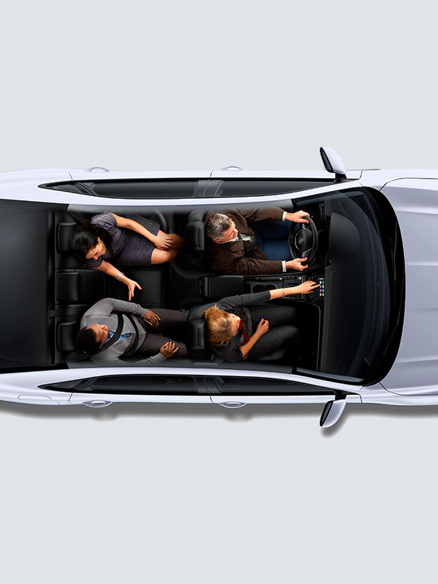 Two couples seated in Reflex Silver Metallic Passat seen from overhead