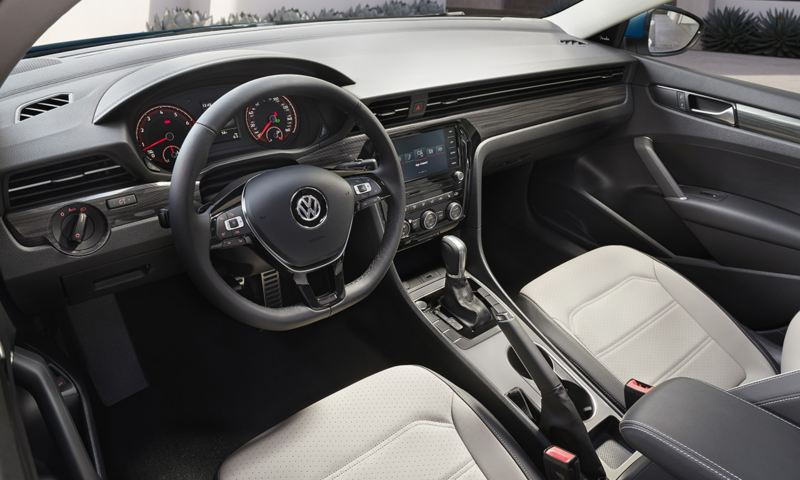 Interior view as seen from the driver's seat of a Passat in available Shetland and Titan Black leatherette