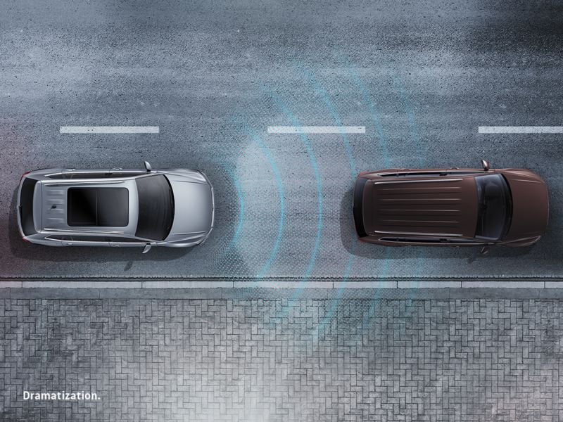 Glowing lines emit from the front bumper of a vehicle to illustrate distance from the car in front of it.