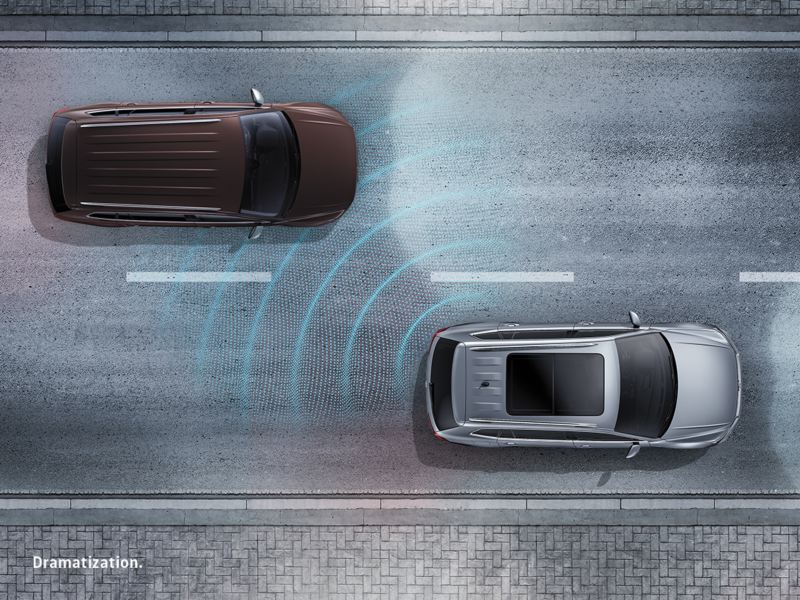 Overhead view of glowing lines emitting from the rear left side of a vehicle.