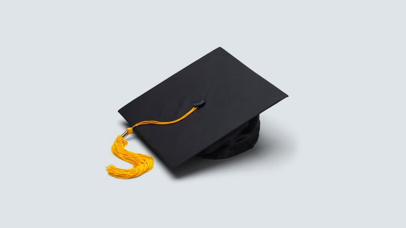 A grad cap with an orange tassel on a white background