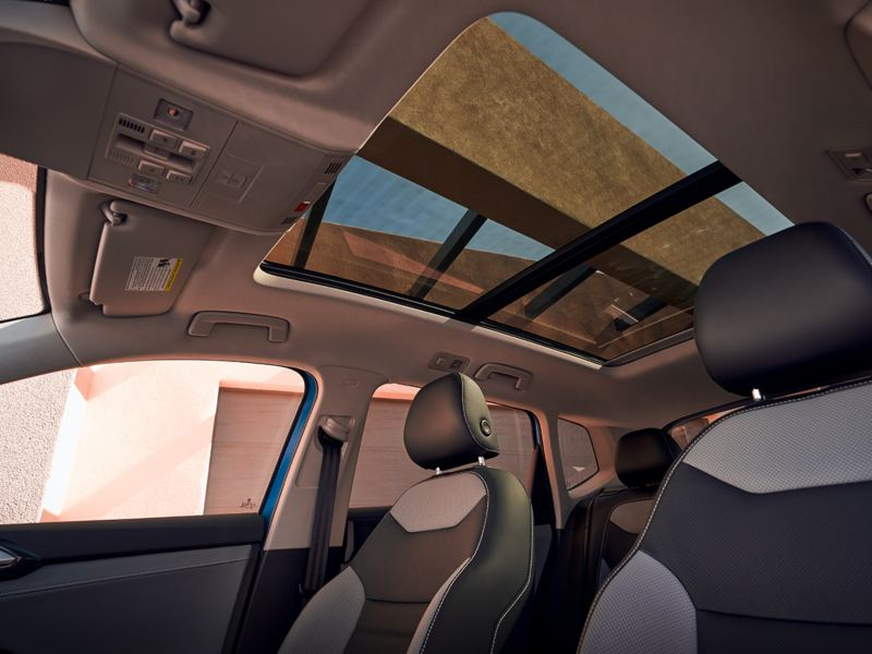 Interior of a VW Taos featuring the panoramic sunroof.